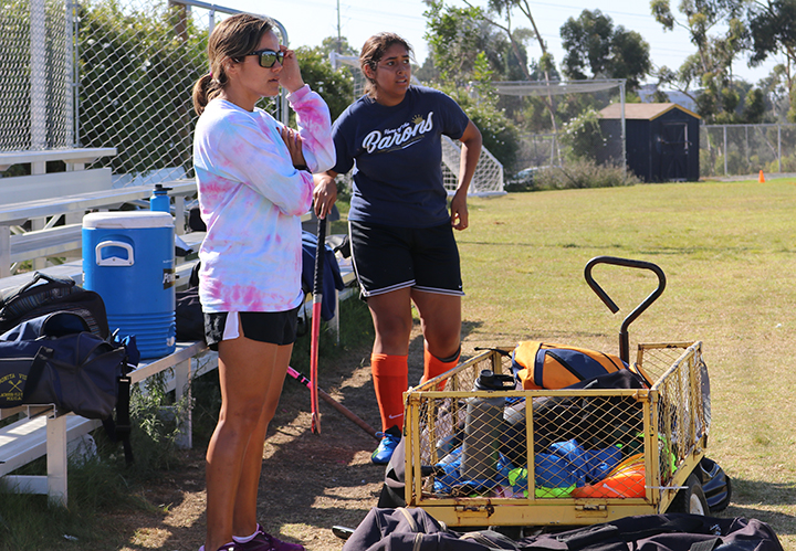 Field+Hockey+Coach+Brianne+Paxton+supervises+her+varsity+team+as+they+run+during+practice.++The+team+practices+from+4+p.m.+until+6%3A30+p.m.+on+weekdays+that+they+do+not+have+games.