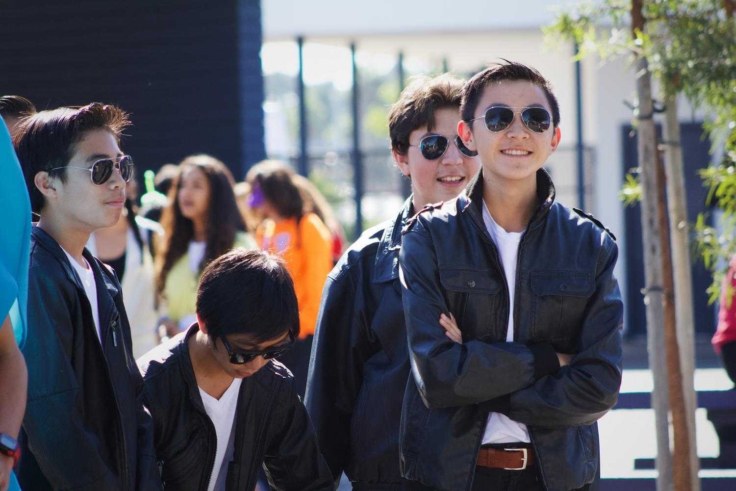 Greaser stands, smiling after finding out that him and his clan won the costume contest.