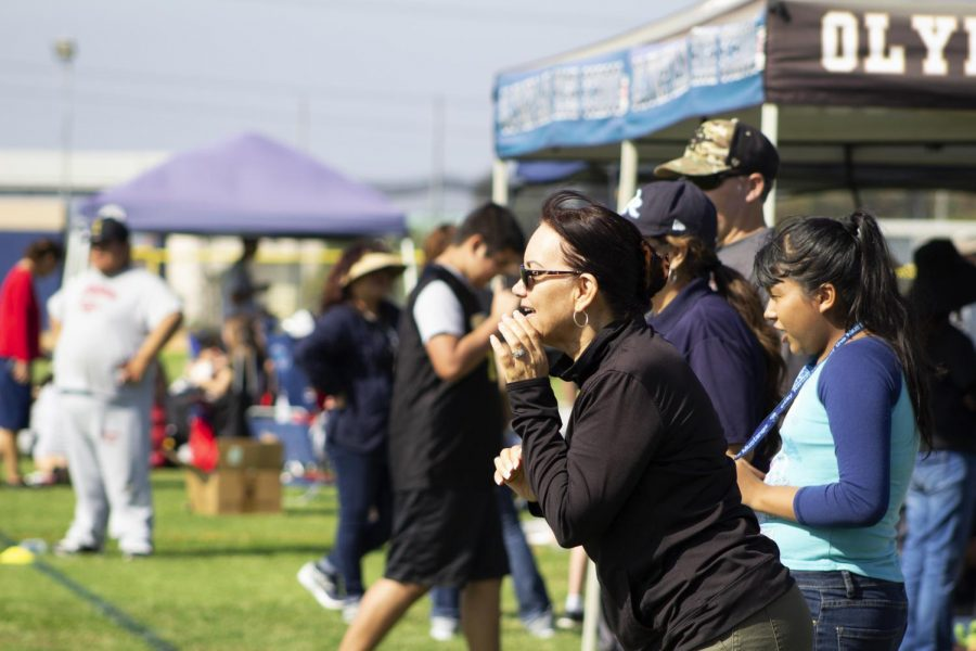 A mother of a child participating in the Unified Sports Soccer game cheers them on.