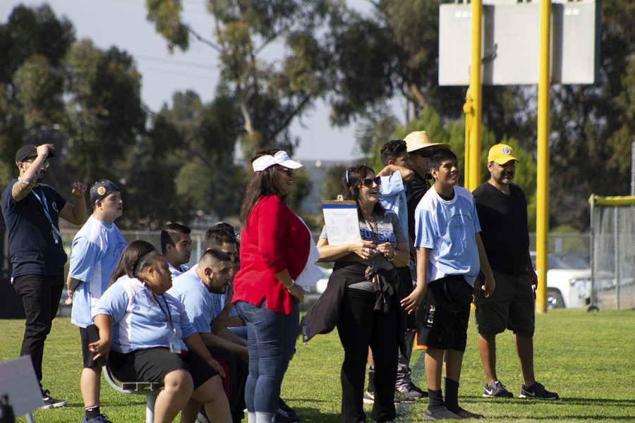 San Ysidro High participants and aids cheer on their team participating in a soccer game.