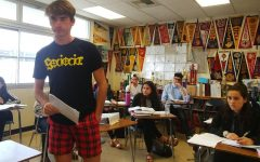 Senior John Clamon acts as defense attorney during an IB English Literature HL group project.