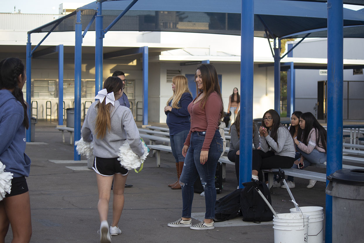 Junior and Bonita Vista Middle cheer assistant coach Victoria Turrubiartes, pictured left, instructs a cheer practice. It is her second year coaching the team.