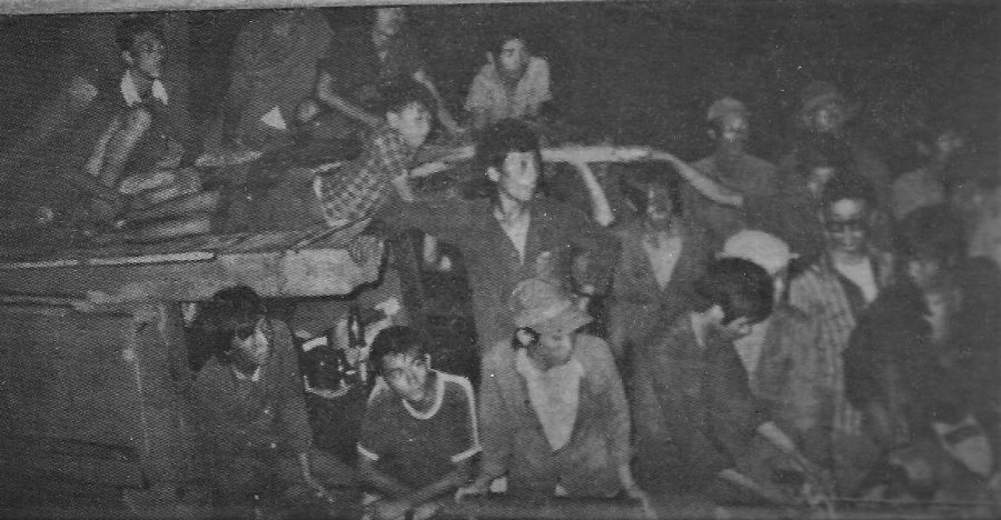 An original photo of the 85 Vietnamese refugees who were rescued by an American submarine. BVH Introductory Engineering and Integrated Math II teacher Wayne Lee is present among the refugees.