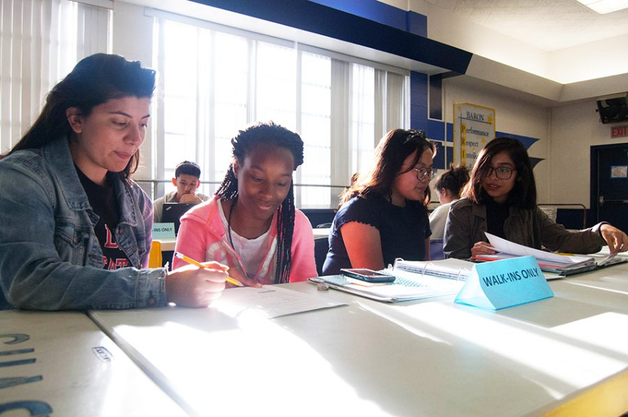 MSTI tutors Zahira Chayeb and Miriam Maldonado work with BVH students at a TEAM tutoring session. TEAM tutoring meets after school in the cafeteria.