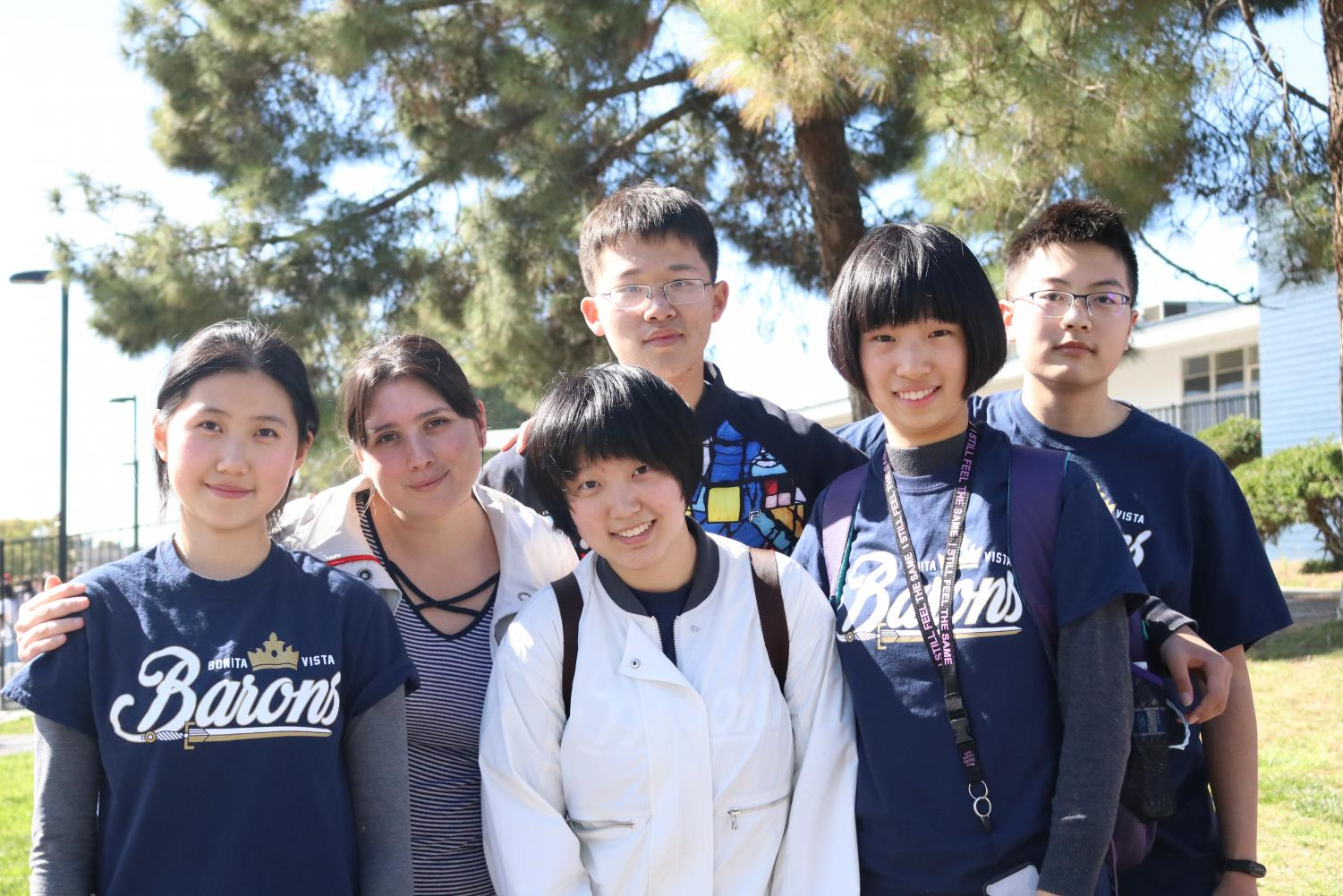 Five of the chinese exchange students pose alongside Program Coordinator Carla Ruiz-Velasco. This was one of the last things they did before driving away on one of the Sweetwater Union High School District school buses from their final day on the Bonita Vista High campus.