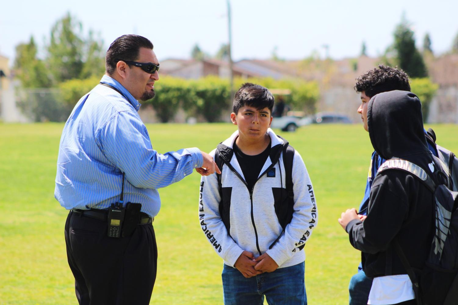 Assistant principal, Carlos Saucedo, tells a group of freshman to leave the field during a walk-out, while he had told others if they were on the field that they couldn't leave.