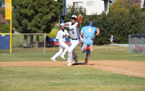 Senior and first baseman Isaac Almendarez (8) reaching out to catch the baseball with his right foot still touching the base. Senior and second baseman Caiden Regadio (9) runs behind him to back up Alamendarez.