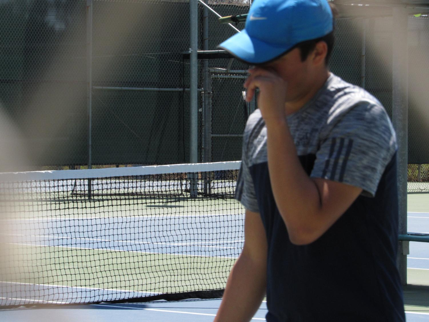 Senior Eduardo Rosario lowers his head, almost in defeat, of opposing team Francis Parker. They would go on to lose the match with a final score of 6-2.