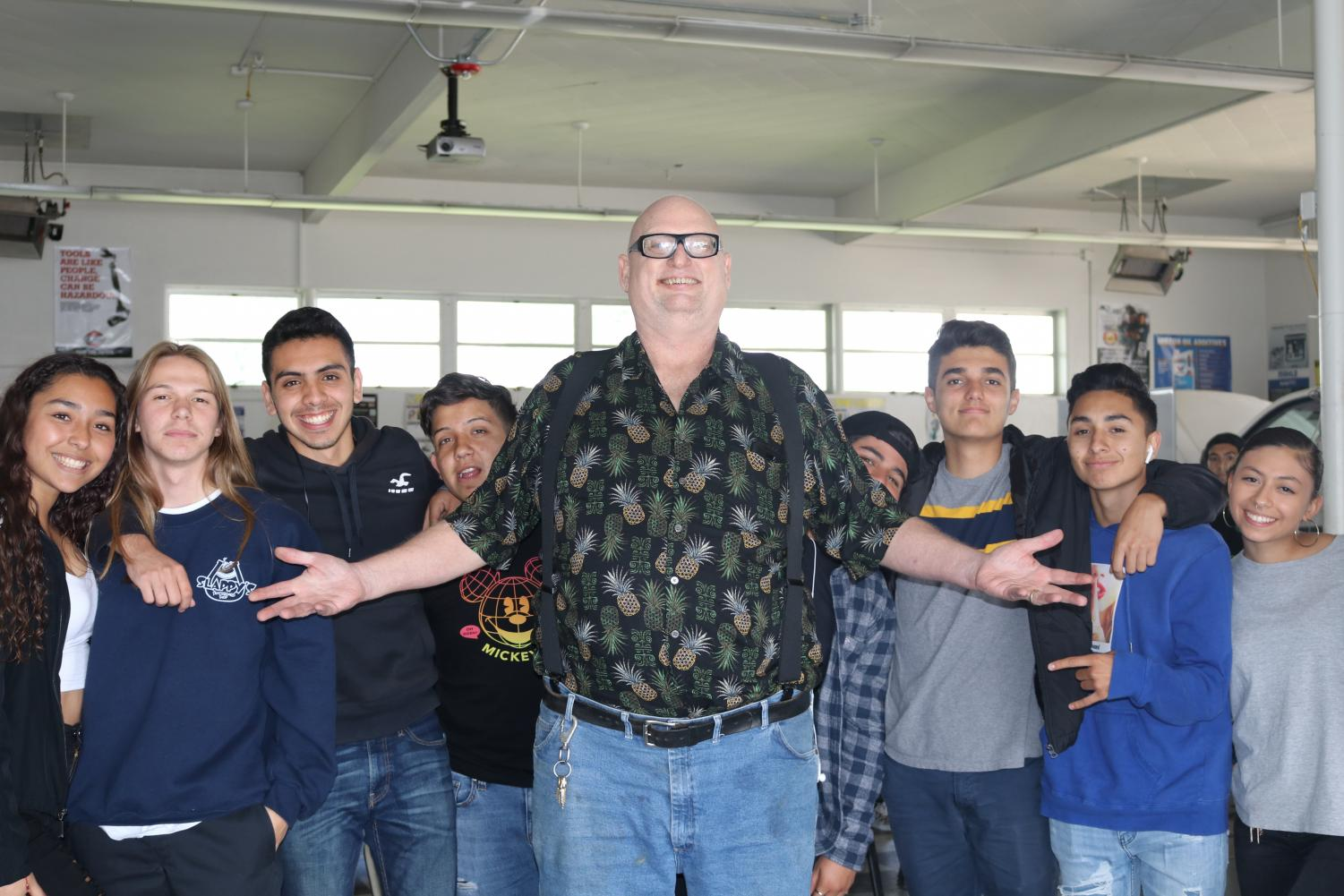 Ben Hazel poses with his sixth period students during his final days teaching at Bonita Vista High. He prepared the auto shop for the next teacher to take over.