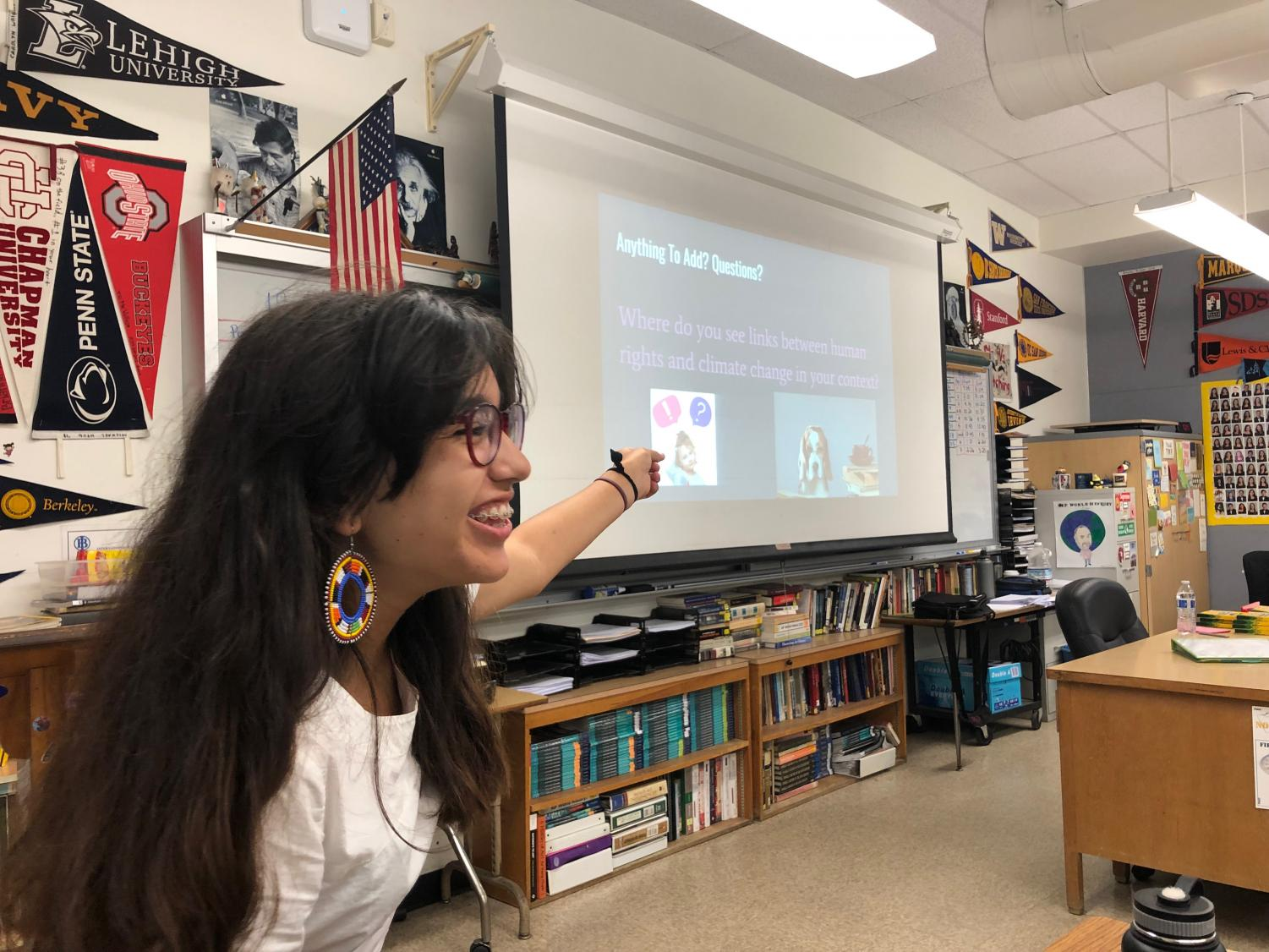 Junior Alicia Verdugo laughs as she addresses questions asked by the members for Amnesty International in room 211. Verdugo currently acts as president of Amnesty International.