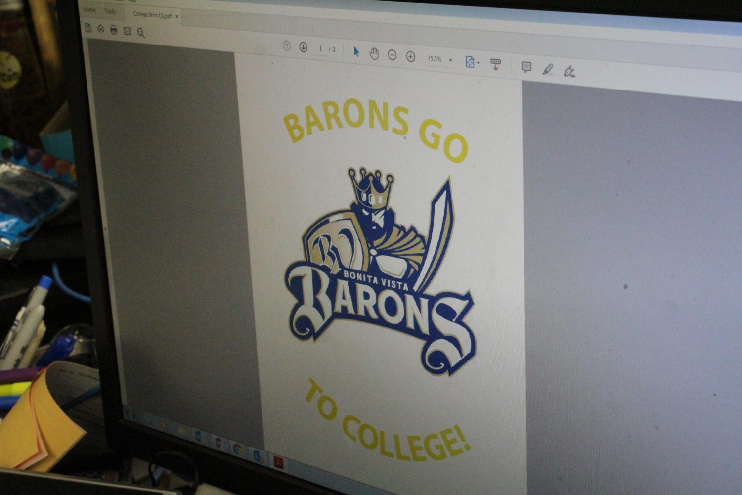 Dr. Michelle Mardahl-Dumesnil displays the design for the college t-shirts that are going to be distributed at BVH to encourage college-readiness. The logo was designed by junior Lucia Rivera.