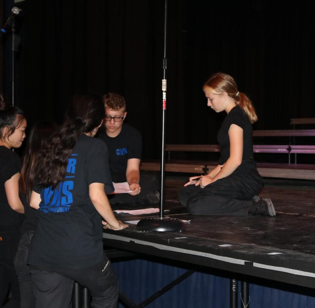 VMD techs, including freshman Jacqueline Vogel-Fux (pictured right), prepare for the upcoming anniversary performance of Scream in its original venue: Bolles Theatre.