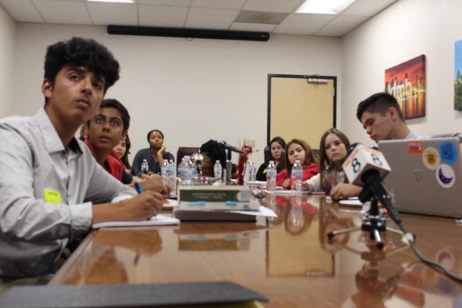 Students from all over San Diego County participate in the student panel to discuss the democratic presidential debate. The students took notes on the candidates' proposed policies to later be discussed during their break.