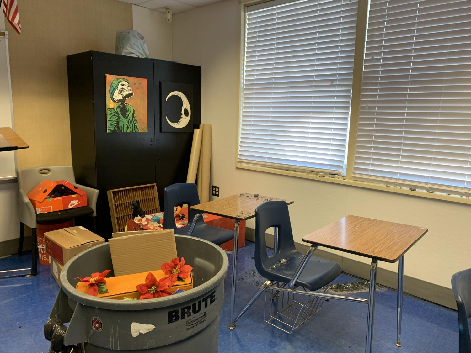 Room 802 as discovered by de la Cruz the morning of Nov. 4, 2019. In the trash bin is a student altar thrown away due to damage from the shattered glass.