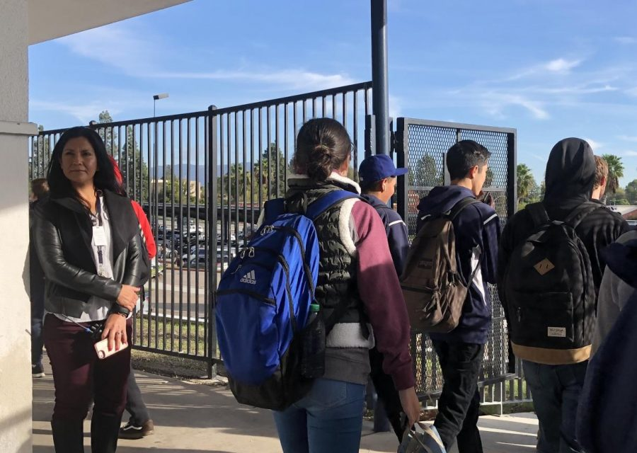 Assistant Principal Esther Wise observes students exiting the campus near the ASB. Wise supervises the several Campus Assistants at BVH who monitor areas of the school every day.
