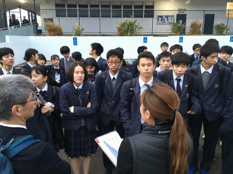 On Wednesday, Nov. 20th, 2019, International Japanese delegates wait for their assigned guides to arrive. The delegates were taken to the cafeteria before following their guides around the school and to their classes.