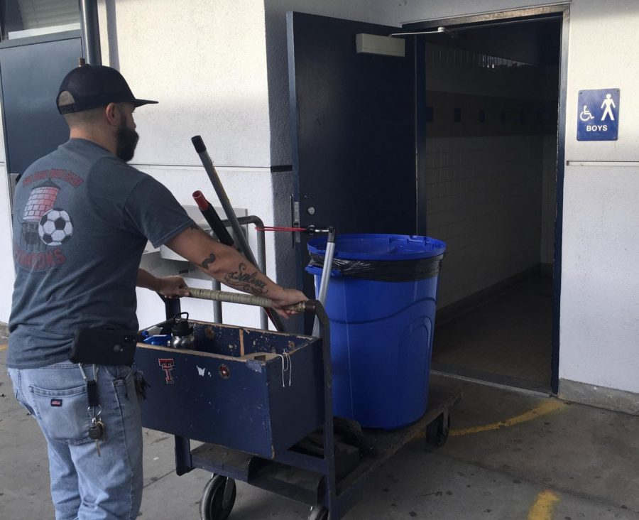 Custodian Sergio Mirmolejo enters the 500s building boys bathroom on Monday, Dec. 2. He cleans this bathroom almost everyday after school and often is faced with a heavier workload when having to fix appliances that have been vandalized or broken by students.