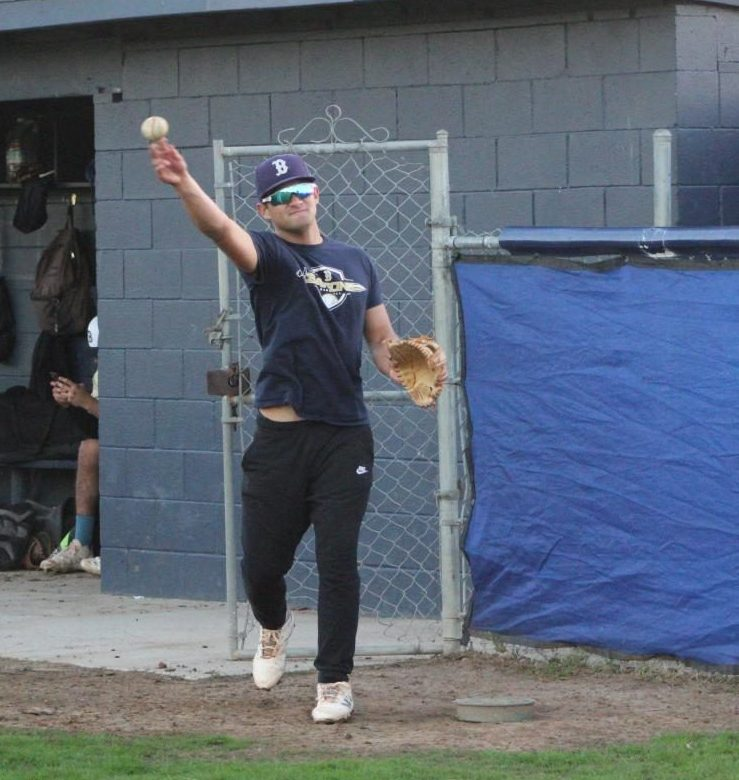Daniel Mcelveny, who is a junior,  varsity baseball player and commit- ted to University of San Diego (USD),  is practicing with a coach as practice is starting to end.