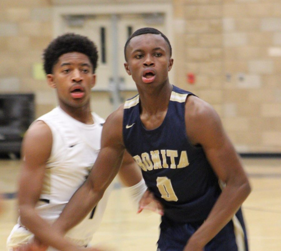 "Point guard and junior, Damajae ""DJ"" Sanders (right) drives down the court to Mater Dei's hoop. In the end, Bonita fell short with a score of 76-87."