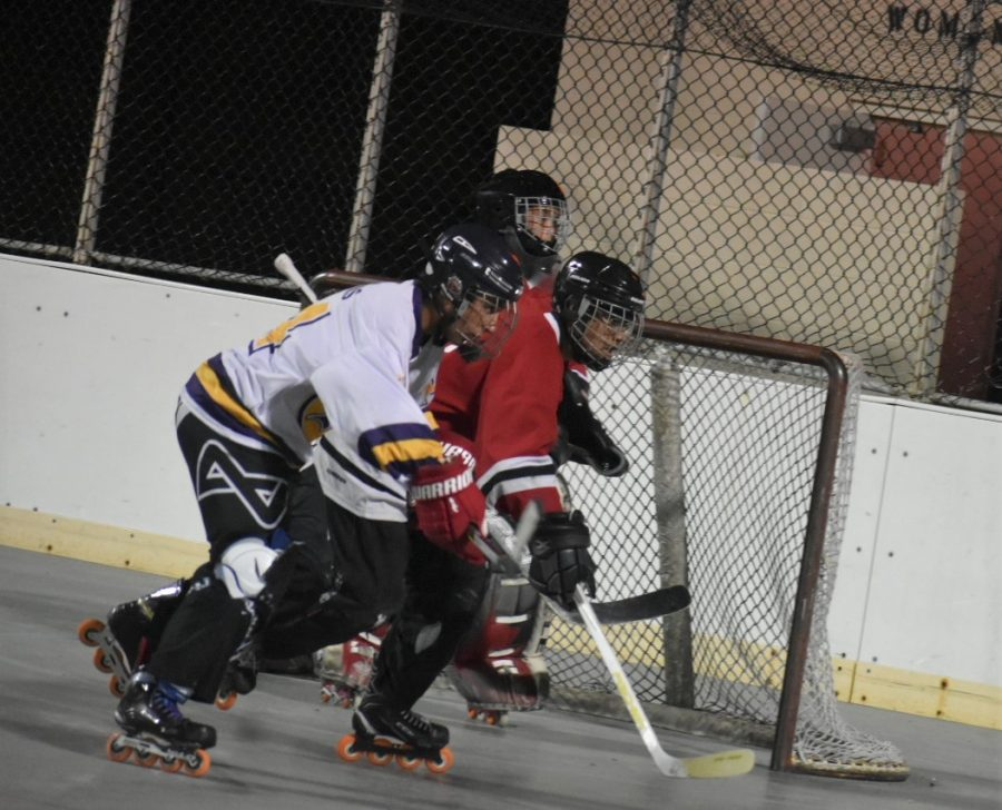 Forward and sophomore Diego Nunes (14) skates alongside an opposing player during the match. After the game, Nunes stated that he felt the BVH team played well.