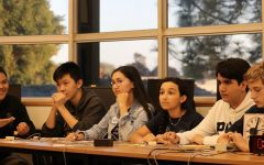 Varsity Quiz Bowl members (left to right) senior AjaniOquendo, sophomore Henry Tang, junior Ursula Neuner, junior Lucía Rivera and junior Gerardo Gonzalez hold their buzzers during the match. At this point, their opponents were several hundred points ahead.