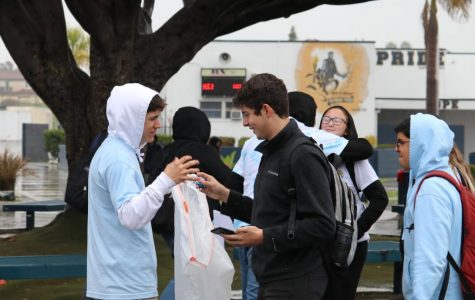 Associated Student Body (ASB) Secretary candidate, eventual winner and junior Noah Zelaya (left) greets potential voters in the BVH quad. Several candidates passed out trinkets or candy during their campaigns.