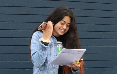 Junior and Visual and Performing Arts (VAPA) Commissioner in ASB Amari Adrianzen takes notes as she listens to music from her phone in preparation for choreographing dances for the upcoming school functions