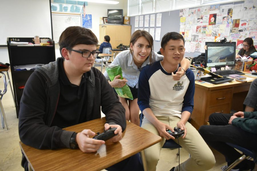 IB+English+HL1%2C+English+9+Accelerated+and+Esports+club+advisor+Raymond+Chhan+%28right%29+plays+Super+Smash+Bros+with+junior+Dillan+Busk+%28left%29.+Students+were++receiving+tips+from+BVH+alumnus+Georgina+David+%28middle%29+who+often+visits+campus+to+watch+Chhan%E2%80%99s+matches.