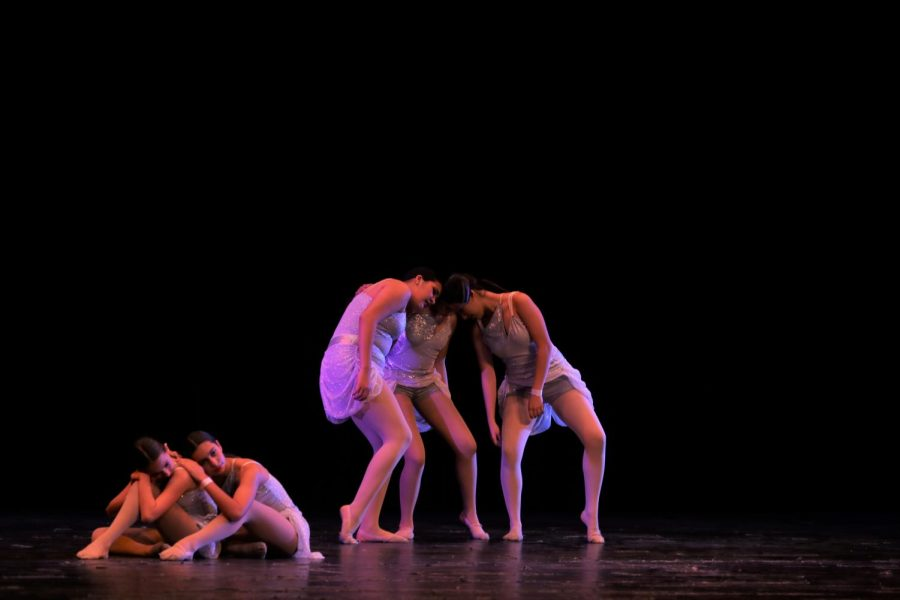Dancers from the San Diego Dance Academy perform a contemporary dance at Eastlake High's Ruth Chapman Hill Theater on Feb. 28.  The performers are barefoot and portray a story using facial expressions.