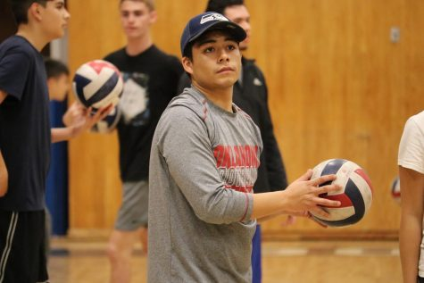 BVH Boys varsity volleyball coach Luis Contreras instructing his squad at practice on Mar. 12. Contreras, who coached both the BVH Girls freshman and Boys junior varsity volleyball for the past two years, was given the position of head coach for the Boys varsity volleyball at the start of 2020.