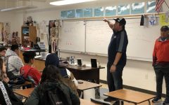 Athletic Director Tyler Arciaga presents the new coaching staff to the BVH Football program at their meeting on Mar. 13.