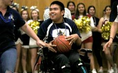 Senior Charlie Peterson receives a pass of the basketball on Mar. 5 at the Unified Basketball game. Cheerleaders from both Bonita Vista High and Southwest High cheer on the Unified teams of Special Education and General Education students from both schools,