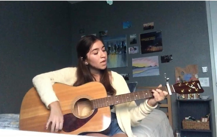"Madison Geering plays the guitar and sings ""Underneath Your Clothes"" by Shakira. To her, this song represents loving others for who they truly are."