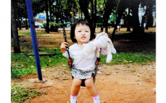 In 2007, Yealin Lee is on a swing with her plush doll, Kimchi. She brought Kimchi wherever she went.