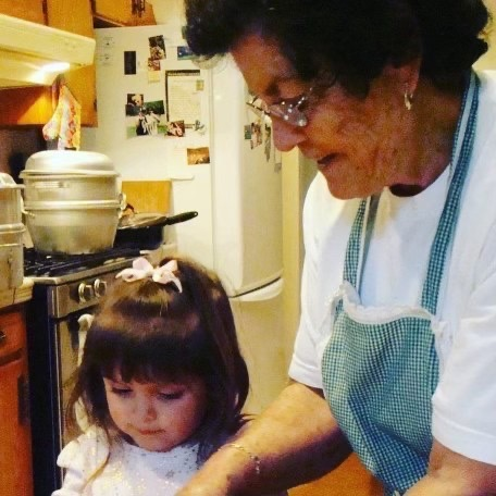 Maria Delgado makes tamales with her grandmother during the holiday season. Maria Delgado cherishes the times she spent baking with her grandmother.