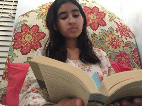 Pickwick Club co-President sophomore Giselle Geering reading Pride and Prejudice by Jane Austen before going to sleep. Geering is reading in preparation for the next Pickwick Club meeting. The club meets on Mondays at 12:20pm.