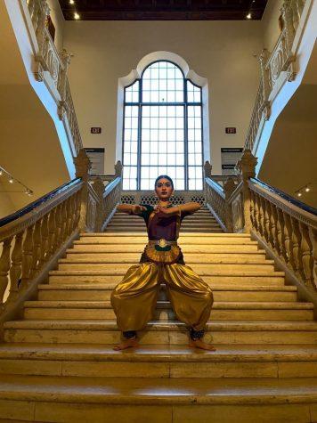 Senior Anoushka Savgur performs the traditional Indian dance known as Bharatanatyam at the Natesha School of Bharatanatyam. This performance is one of Savgur