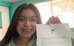 Junior Mia Gonzalez poses with a letter received from the Carson Scholars Fund. She received news of her win in March 2021 after applying in January.