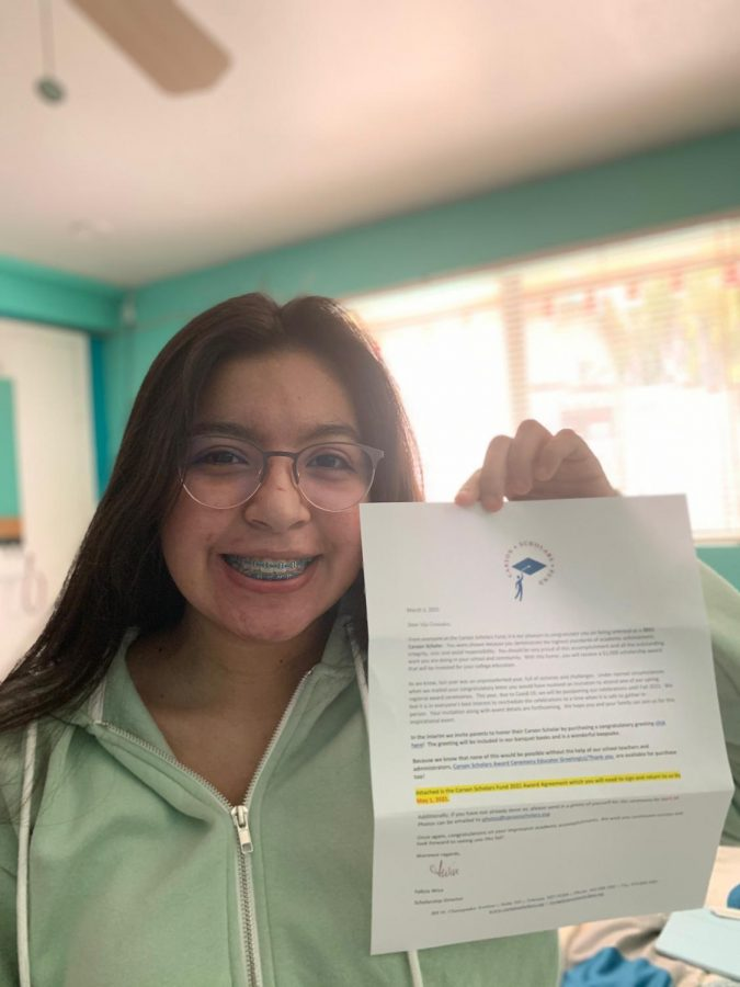 Junior+Mia+Gonzalez+poses+with+a+letter+received+from+the+Carson+Scholars+Fund.+She+received+news+of+her+win+in+March+2021+after+applying+in+January.