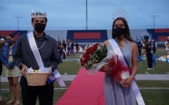 Bonita Vista High (BVH) 2021 Homecoming King, Frankie Javier and Homecoming Queen, Madison Bianes pose for the camera in front of the Color Guard. Standing at the end of the red carpet, Javier and Bianes were announced as the King and Queen at a football game.