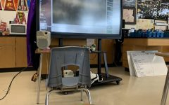 Bonita Vista High International Baccalaureate Biology Higher Level, Advanced Placement Biology and Accelerated Biology teacher Michelle Mardahl-Dumesnil smart board plays a video to her in-person students. During her third period class the Google Meets call is played on the screen.