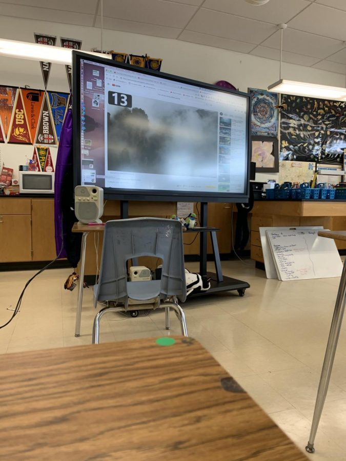 Bonita+Vista+High+International+Baccalaureate+Biology+Higher+Level%2C+Advanced+Placement+Biology+and+Accelerated+Biology+teacher+Michelle+Mardahl-Dumesnil+smart+board+plays+a+video+to+her+in-person+students.+During+her+third+period+class+the+Google+Meets+call+is+played+on+the+screen.