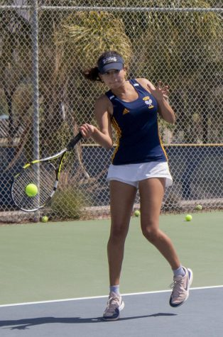 Junior Bibiana Martinez strikes the ball sideways towards her opponents. Martinez won 1st place in girls