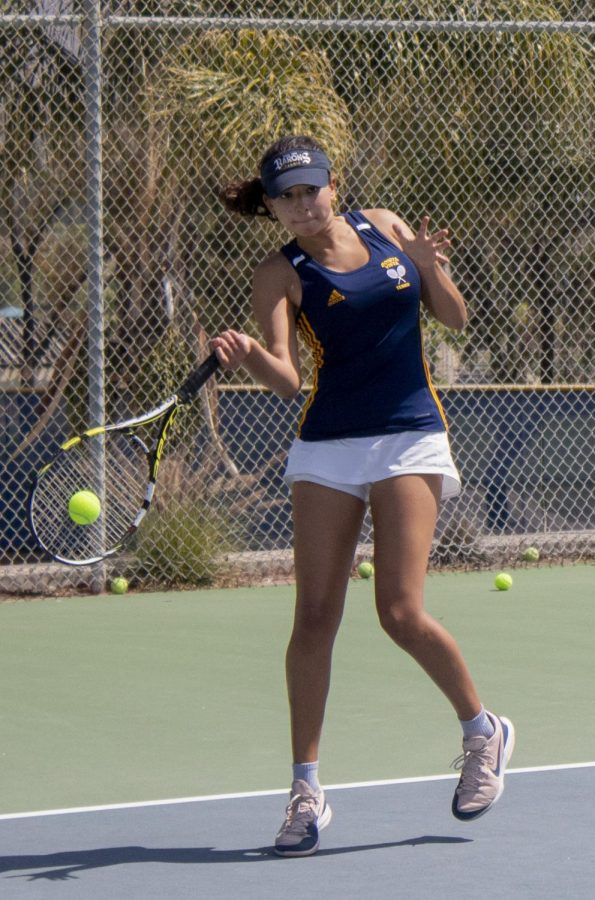 Junior Bibiana Martinez strikes the ball sideways towards her opponents. Martinez won 1st place in girls' doubles at the tournament.
