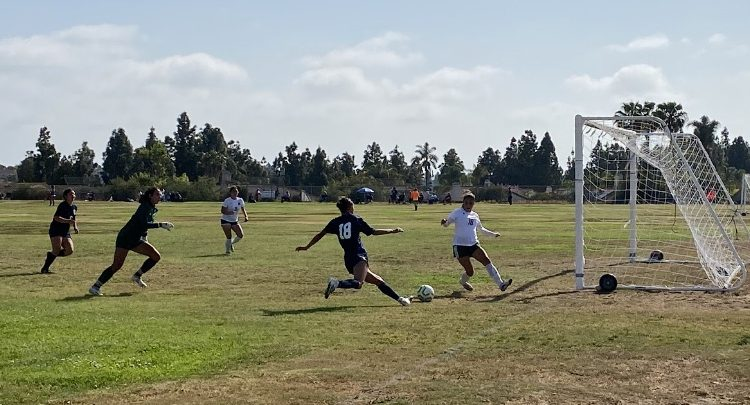 BVH varsity girls soccer forward and junior Vanessa Ramirez (18) shoots the ball and gives the Barons one more goal. Ramirez scored the first two goals of the game, giving them a 2-0 lead.