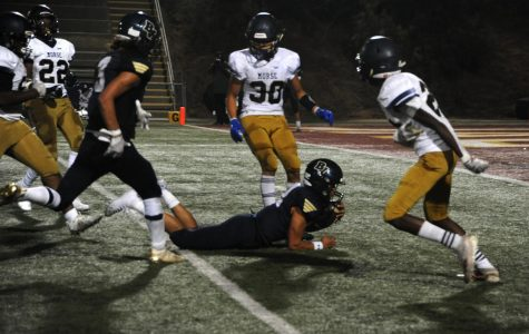 Bonita Vista High (BVH) football team plays against Morse High (MH) on  Friday, Aug. 20 at Southwestern College. BVH wide receiver Malosi Iuli (3) rushes to gain possession of the football as they are surrounded by MH players.