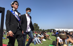 Homecoming Prince Michael Dimapilis and Mr. Chhan make their way to the stage. The crowd cheers as Dimapilis takes his seat alongside the rest of the Homecoming court.