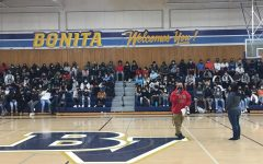 Assistant Principal Christopher Alvarez announces the confirmation of homecoming and gradnight to the class of 2022 during the morning assembly on Oct. 13. Following the announcement, IB Math A&A teacher Christina Ada provided further information with rules and expectations the student body would be expected to follow.