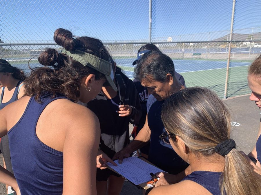 Left to right: Bonita Vista High (BVH) girls tennis captain, Number Two Doubles player and senior Bibiana Martinez, BVH girls tennis coach Joseph Sheffield and Number One Doubles Player and sophomore Paola Nirmal are huddling together before the match. They are discussing what positions they will play, a decision that ultimately determined the outcome of the game.