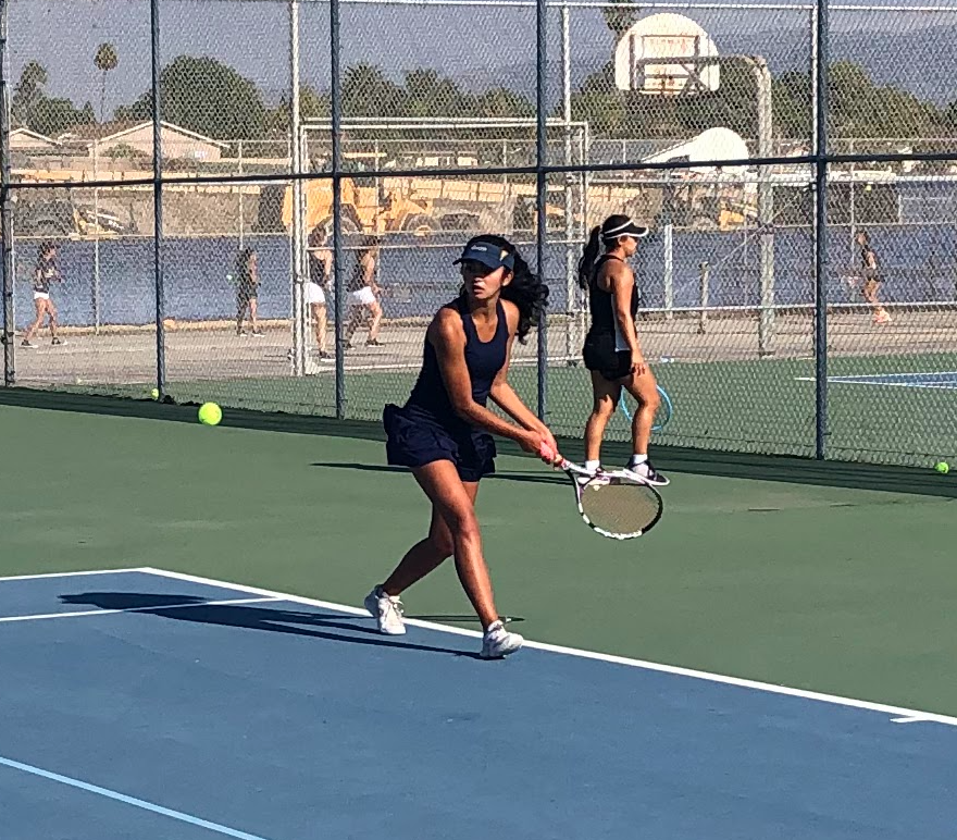 Captain and senior Alexa Fakhimi uses a backhand swing to hit the lower ball. On October 5th 2021 BVH beats Eastlake at the Tennis Courts of BVH.